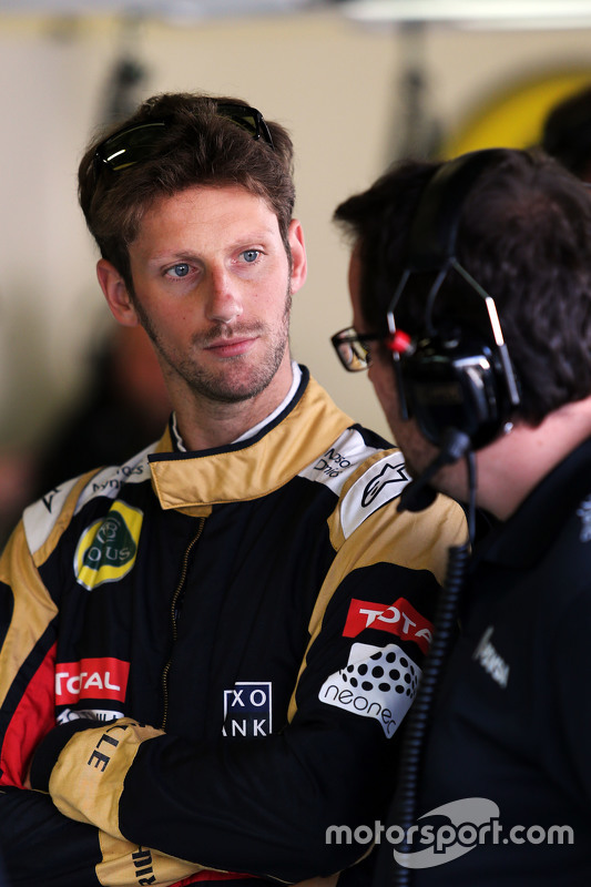 Romain Grosjean, Lotus F1 Team com Julien Simon-Chautemps, engenheiro de corrida da Lotus F1 Team