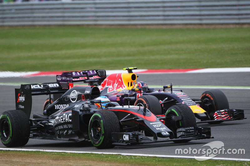 Fernando Alonso, McLaren MP4-30 and Daniil Kvyat, Red Bull Racing RB11 battle for position