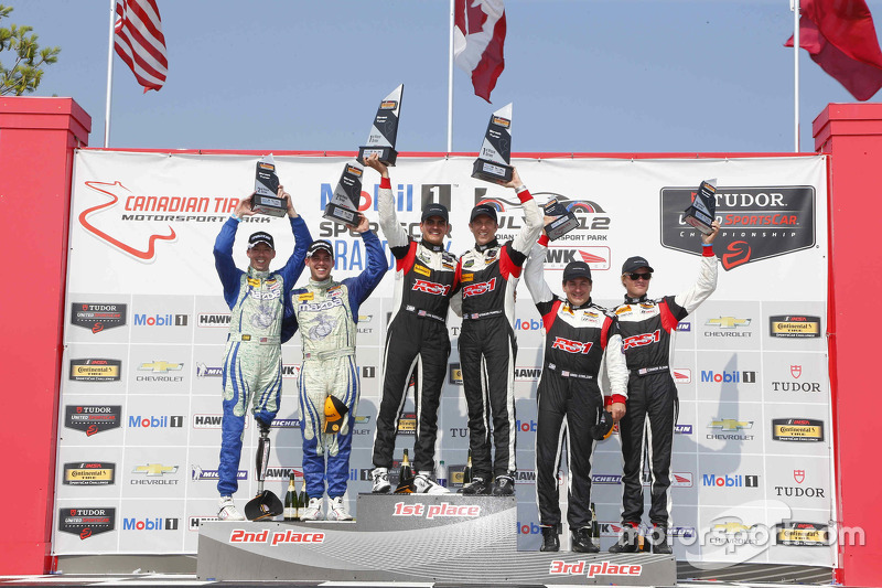 Podium: Race winners #17 RS1 Porsche Cayman: Spencer Pumpelly, Luis Rodriguez Jr., second place #26