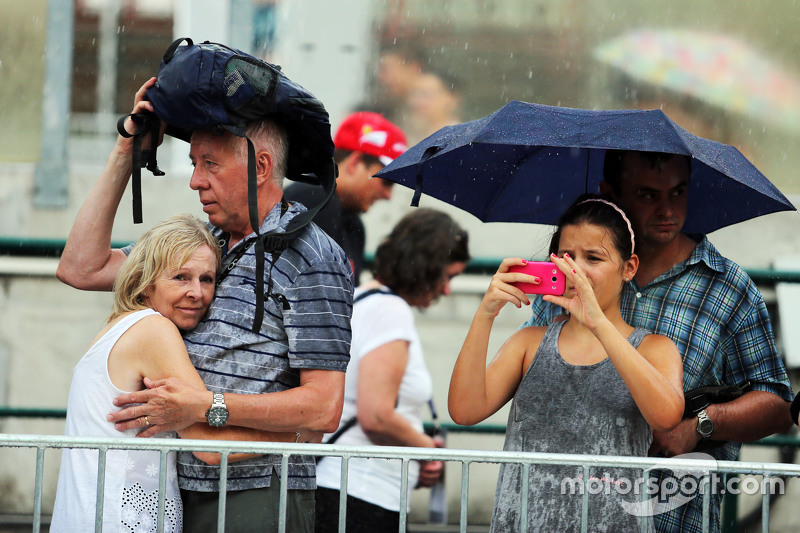 Fans in the pits during a rain storm