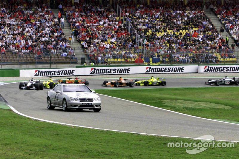 Mika Hakkinen, McLaren leads behind the safety car