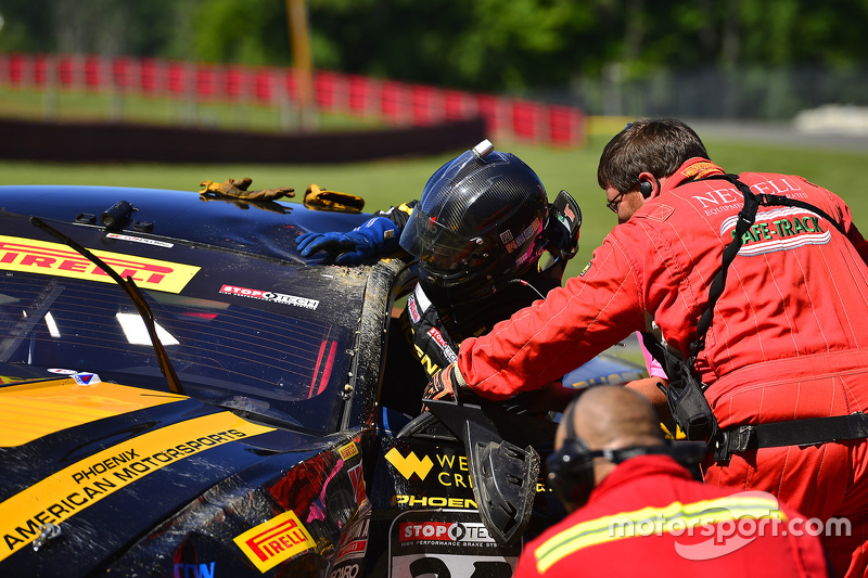 Safety crews work after a hard crash for #35 Phoenix American Motorsports Ford Mustang Boss 302: Preston Calvert