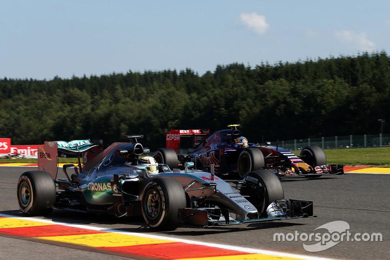 Lewis Hamilton, Mercedes AMG F1 W06 and Carlos Sainz Jr., Scuderia Toro Rosso STR11