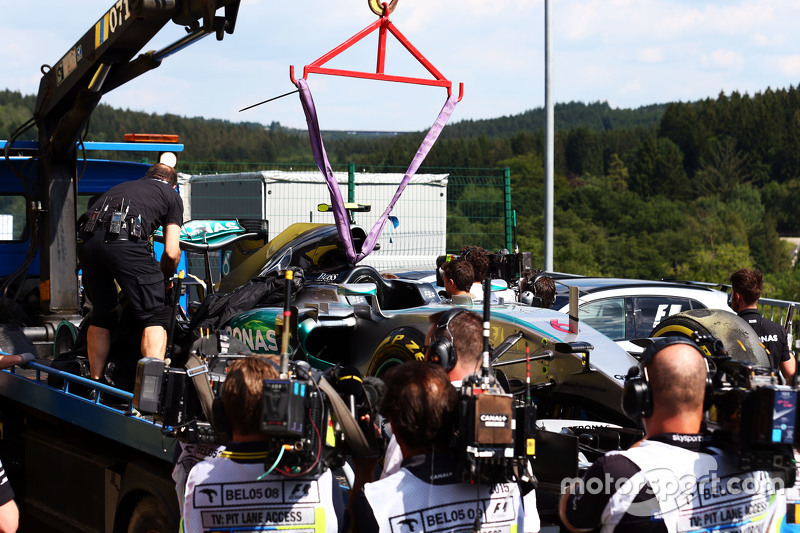 Mercedes AMG F1 W06 of Nico Rosberg, Mercedes AMG F1 is recovered back to pits on back of a truck di