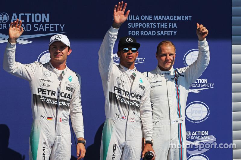 Qualifying top three in parc ferme,: Nico Rosberg, Mercedes AMG F1, second; Lewis Hamilton, Mercedes