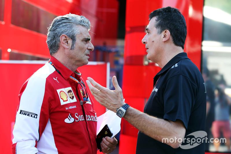 (L to R): Maurizio Arrivabene, Ferrari Team Principal with Federico Gastaldi, Lotus F1 Team Deputy T