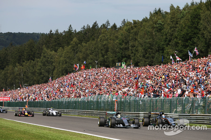 Lewis Hamilton, Mercedes AMG F1 W06 and Sergio Perez, Sahara Force India F1 VJM08 battle for the lea