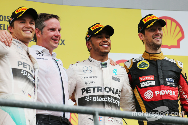 Podium: Romain Grosjean, Lotus F1 Team, second; Lewis Hamilton, Mercedes AMG F1, race winner; Romain Grosjean, Lotus F1 Team, third