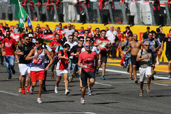 Fans invade the circuit and run to the podium