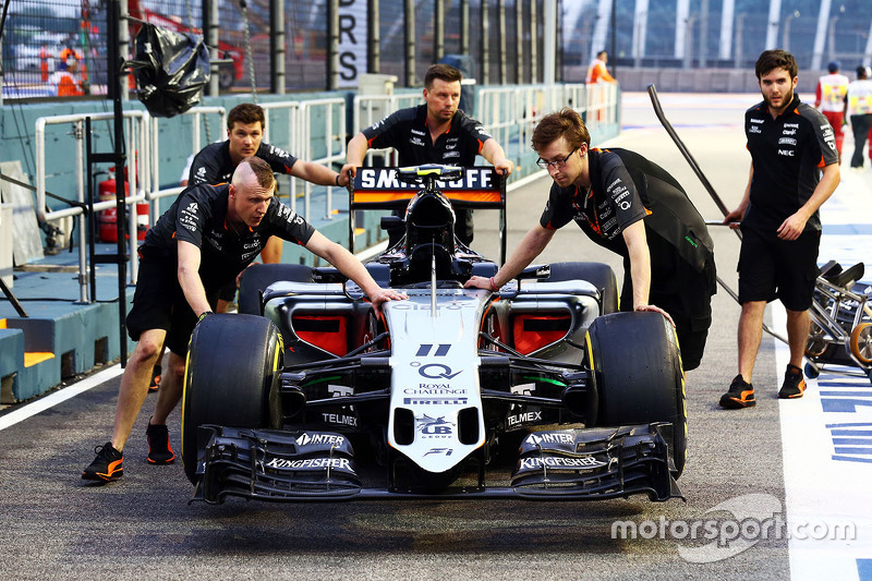 The Sahara Force India F1 VJM08 of Sergio Perez, Sahara Force India F1 is pushed by mechanics to scrutineering