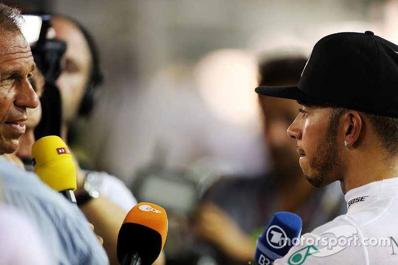 Lewis Hamilton (GBR) Mercedes AMG F1 with the media after he retired from the race