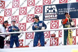 Podium: race winner Nelson Piquet, Benetton, second place Roberto Moreno, Benetton, third place Aguri Suzuki, Larrousse