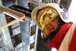 A Corvette reflection on a fire marshall's helmet