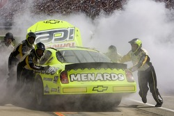 The Menards Chevrolet is pushed back to the garage with engine problems