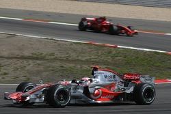Fernando Alonso, McLaren Mercedes, MP4-22 and Kimi Raikkonen, Scuderia Ferrari, F2007