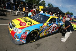 Cheerios Dodge crew members push the car to tech inspection