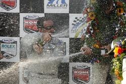 DP podium: champagne for Jim Matthews and Marc Goossens