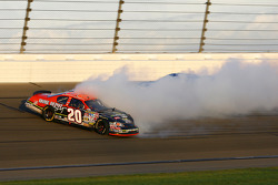 Tony Stewart slides through turn 3 on his way to the outside wall after contact with Kurt Busch