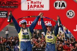 Podium: winners Mikko Hirvonen and Jarmo Lehtinen celebrates