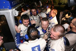 Peugeot Total team members celebrate 2007 Le Mans Series championship and race win