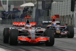 Gary Paffett, Test Driver, McLaren Mercedes, MP4-22 and Sébastien Bourdais, Scuderia Toro Rosso, STR02