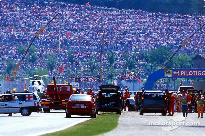 The fatal crash of Ayrton Senna at Tamburello: safety team members at work