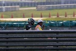 Anthony West return to the pit after crashing his bike