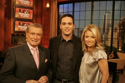 Regis Philbin, Jimmie Johnson and Kelly Ripa pose for a photo after Johnson's appearance on 'Live with Regis and Kelly'