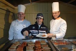 Felix Porteiro serves food
