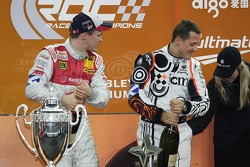 Podium: Race of Champions winner Mattias Ekström celebrates with second place Michael Schumacher