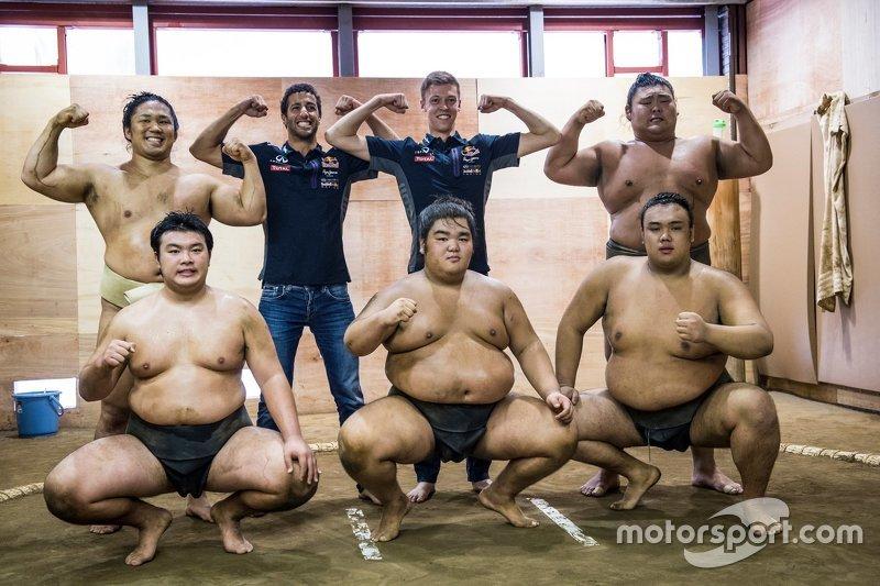 Daniel Ricciardo, Red Bull Racing and Daniil Kvyat, Red Bull Racing pose for a portrait with Sumo wr