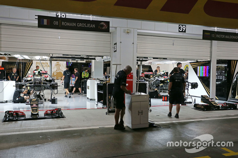 The Lotus F1 Team pit garages at night