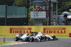Nico Rosberg, Mercedes AMG F1 W06 y Valtteri Bottas, Williams FW37