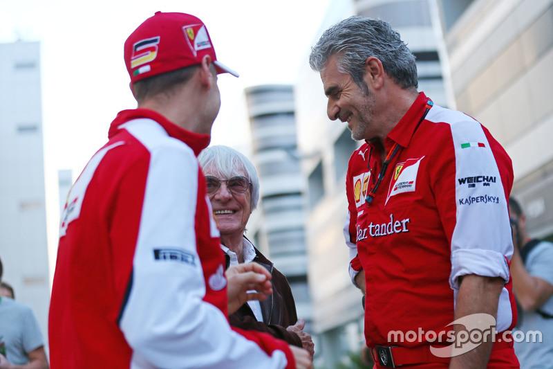 (L to R): Sebastian Vettel, Ferrari with Bernie Ecclestone, and Maurizio Arrivabene, Ferrari Team Principal