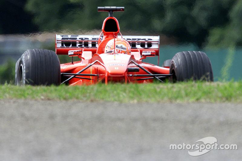 Michael Schumacher takes pole position