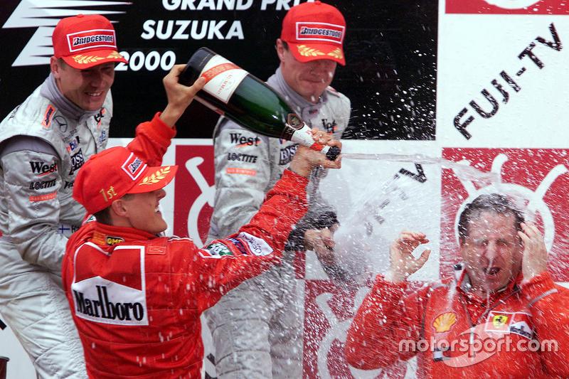 Podio: Il vincitore della gara e del Campionato del Mondo 2000, Michael Schumacher, Ferrari,  il secondo classificato Mika Hakkinen, McLaren, il terzo classificato David Coulthard, McLaren, Jean Todt