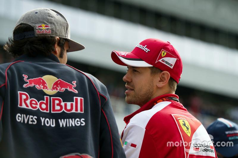 (L to R): Carlos Sainz Jr., Scuderia Toro Rosso with Sebastian Vettel, Ferrari on the drivers parade