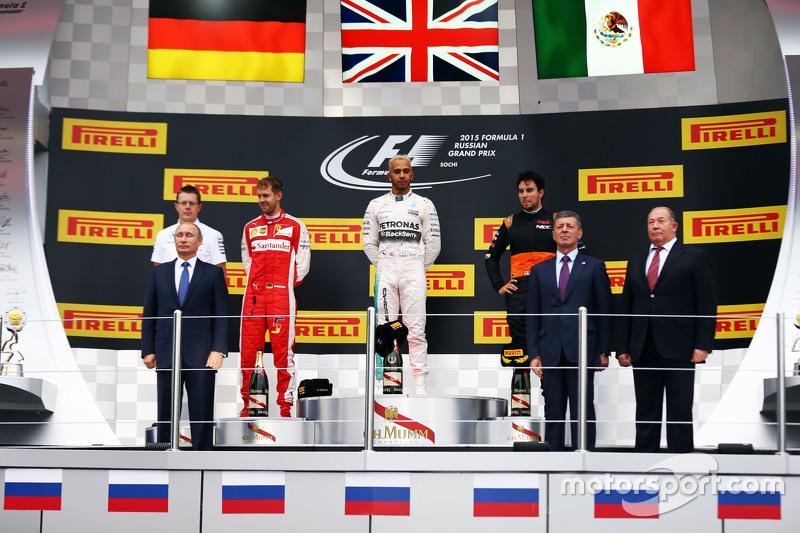 The podium,: Sebastian Vettel, Ferrari, second; Lewis Hamilton, Mercedes AMG F1, race winner; Sergio Perez, Sahara Force India F1, third