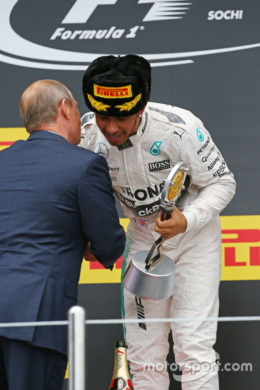 Race winner Lewis Hamilton, Mercedes AMG F1 celebrates on the podium with Vladimir Putin, Russian Fe