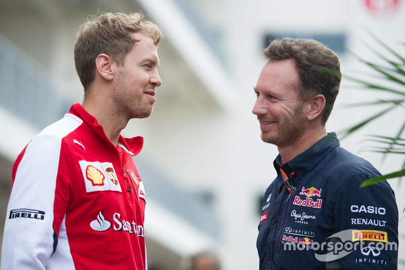 (L to R): Sebastian Vettel, Ferrari with Christian Horner, Red Bull Racing Team Principal
