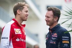 (L to R): Себастьян Феттель, Ferrari з Крістіан Хорнер, Red Bull Racing Керівник команди