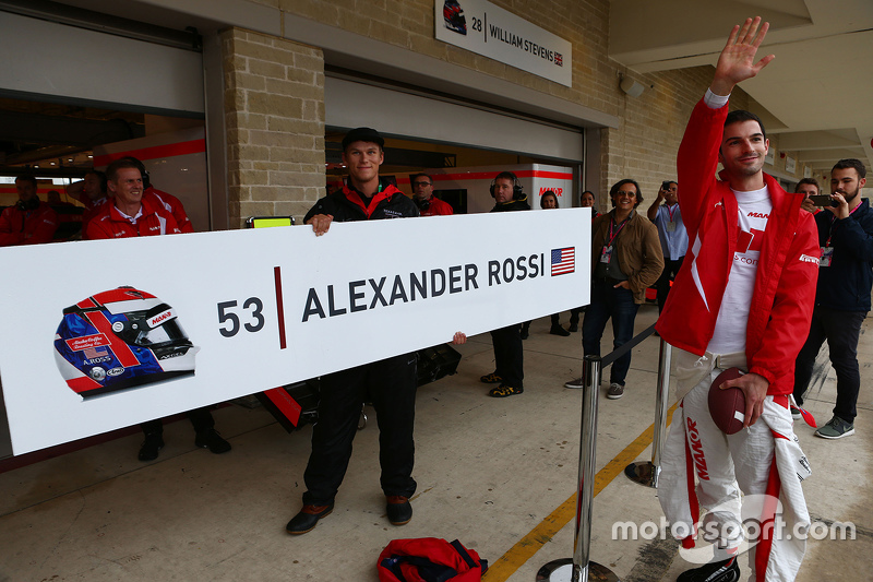 Pit board sign for Alexander Rossi, Manor Marussia F1 Team is erected
