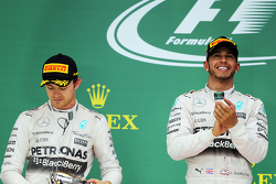 Подиум: победитель гонки и чемпион мира - Льюис Хэмилтон, Mercedes AMG F1, второе место - Нико Росберг, Mercedes AMG F1 W06 и третье место - Себастьян Феттель, Ferrari