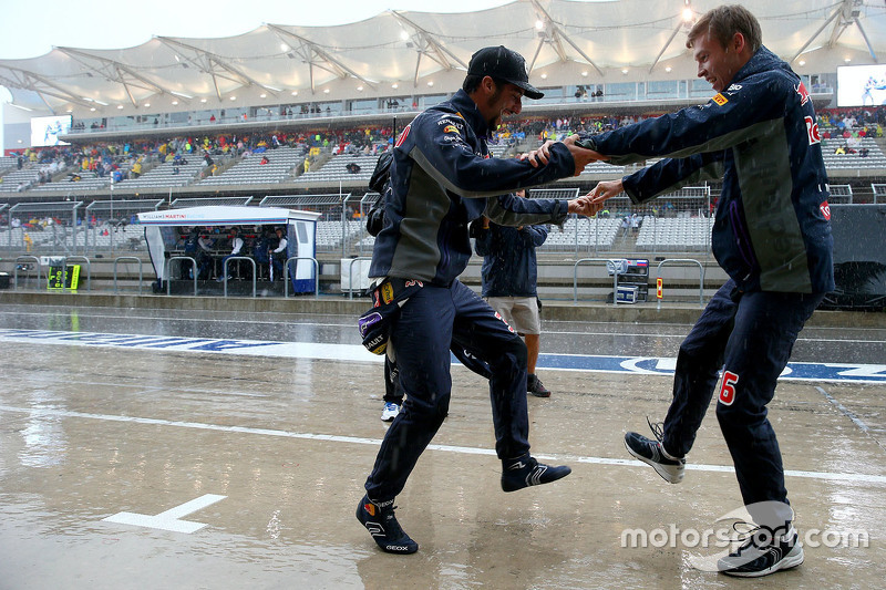 5. Daniel Ricciardo, Red Bull Racing and Daniil Kvyat, Red Bull Racing dance together