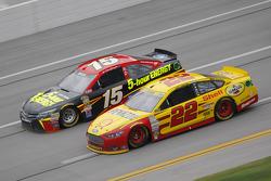 Joey Logano, Team Penske Ford and Clint Bower, Michael Waltrip Racing Toyota