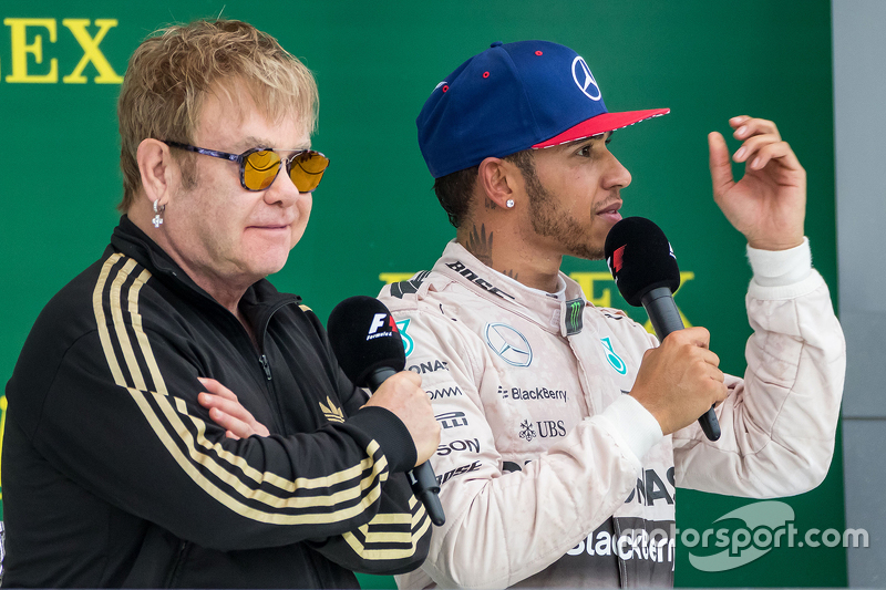 Podium: Sir Elton John, on the podium with race winner and World Champion Lewis Hamilton, Mercedes AMG F2