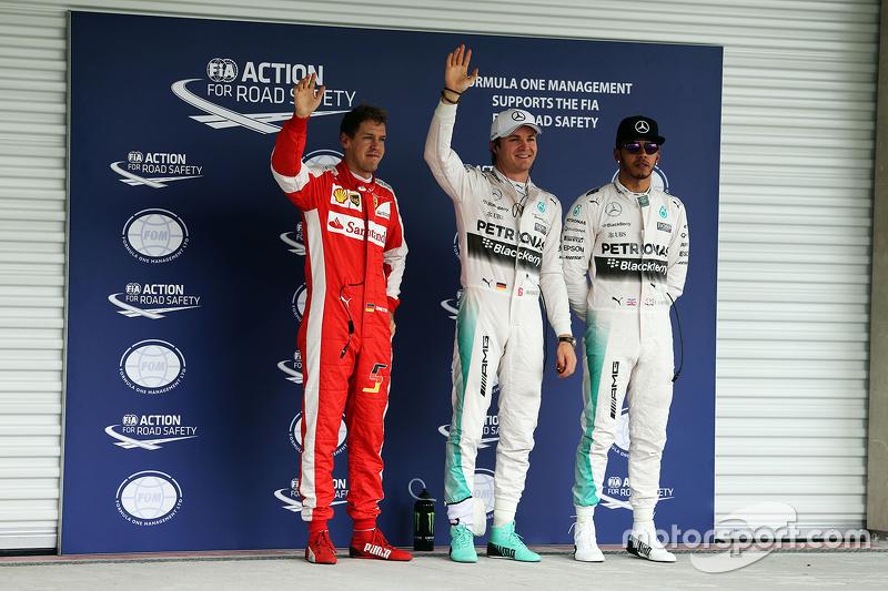 Polesitter Nico Rosberg, Mercedes AMG F1 and third place Sebastian Vettel, Ferrari and second place