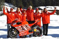 Marco Melandri, Casey Stoner, Vittoriano Guareschi, Claudio Domenicali, Livio Suppo and Gabriele Del Torchio pose with the Ducati Desmosedici GP8