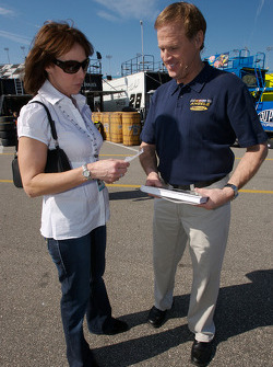 Robin Dallenbach presents her 'Portraits of NASCAR' book to Rusty Wallace