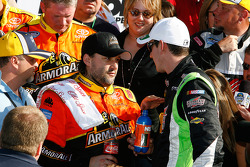 Victory lane: race winner Tony Stewart celebrates with Kyle Busch